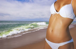 Young woman wearing a bikini on the beach royalty free stock photography