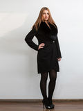 Young woman wearing black classic coat with natural fur collar Royalty Free Stock Photo