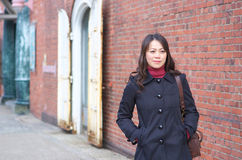 Young woman wearing a black coat Royalty Free Stock Photography