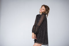 Young woman wearing black dress Royalty Free Stock Image