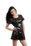 Young woman wearing black and gold sequin dress Royalty Free Stock Photography