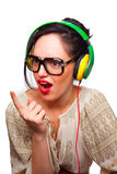 Young Woman wearing Black Large Framed Glasses Listening to Head. Phones and making silly faces Stock Images