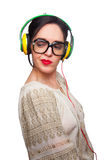 Young Woman wearing Black Large Framed Glasses Listening to Head. Phones and making silly faces Stock Photos