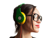 Young Woman wearing Black Large Framed Glasses and Listening to. Headphones Royalty Free Stock Photography