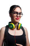 Young Woman wearing Black Large Framed Glasses and Listening to. Headphones Royalty Free Stock Images