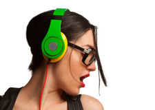 Young Woman wearing Black Large Framed Glasses and Listening to Royalty Free Stock Photos