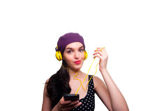 Young Woman wearing Black Polka-Dot dress and Listening to Headp Royalty Free Stock Photo