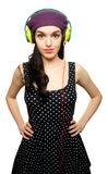 Young Woman wearing Black Polka-Dot dress and Listening to Headp Royalty Free Stock Photos