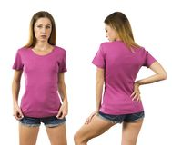 Young woman wearing blank pink shirt. Photo of a woman posing with a blank pink t-shirt ready for your artwork or design royalty free stock photography
