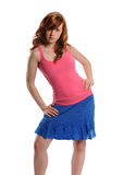 Young Woman wearing a blue dress and pink top Royalty Free Stock Photo