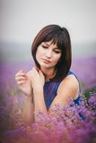 Young woman wearing blue dress standing in a lavender field Royalty Free Stock Images