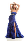 Young woman wearing a blue gown Royalty Free Stock Photography