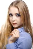 Young woman wearing a blue shirt. Portrait of a beautiful young woman wearing a blue shirt Stock Photo