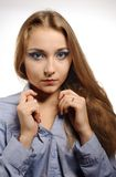 Young woman wearing a blue shirt. Portrait of a beautiful young woman wearing a blue shirt Royalty Free Stock Photography