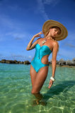 Young woman wearing blue swimsuit and straw hat Stock Photos