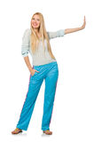 The young woman wearing blue training pants isolated on white Stock Photos