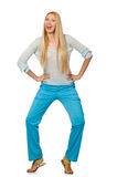 The young woman wearing blue training pants isolated on white Royalty Free Stock Image