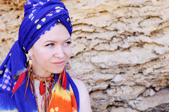 Young woman wearing boho chic scarf on a head and handmade feathers necklace and earrings Stock Images