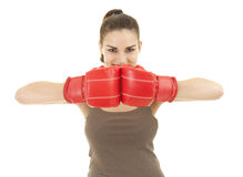 Young woman wearing boxing gloves Royalty Free Stock Images