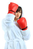 Young woman wearing boxing gloves Stock Photography