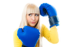 Young woman wearing boxing gloves Royalty Free Stock Photos