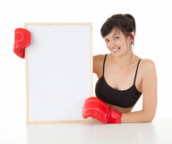 Young woman wearing boxing gloves with blank card Stock Photo
