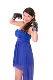 Young woman wearing boxing gloves in casual dress Stock Photos