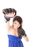 Young woman wearing boxing gloves in casual dress Royalty Free Stock Images
