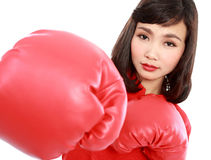 Young woman wearing boxing gloves Stock Images