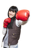 Young woman wearing boxing gloves smiling Royalty Free Stock Image