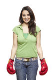 Young woman wearing boxing gloves smiling Royalty Free Stock Photo