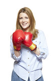 Young woman wearing boxing gloves smiling Stock Images