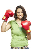 Young woman wearing boxing gloves smiling. On white background Stock Image