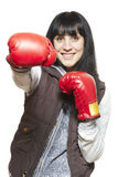 Young woman wearing boxing gloves smiling Royalty Free Stock Photography
