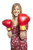 Young woman wearing boxing gloves smiling royalty free stock photos