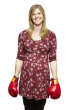Young woman wearing boxing gloves smiling stock photography