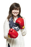 Young woman wearing boxing gloves smiling Stock Photos