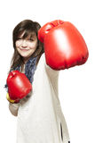 Young woman wearing boxing gloves smiling Stock Image