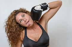 Young woman wearing boxing gloves Stock Photos