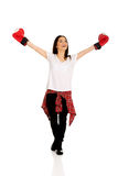 Young woman wearing boxing gloves. Stock Images