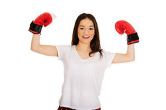 Young woman wearing boxing gloves. Royalty Free Stock Photo