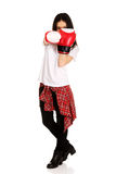 Young woman wearing boxing gloves. Royalty Free Stock Images