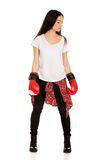 Young woman wearing boxing gloves. Stock Image