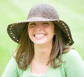 Young Woman Wearing a Brown Hat Stock Photo