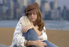 Young woman wearing brown kepi Stock Photos