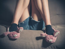 Young woman wearing bunny slippers at home Royalty Free Stock Photos