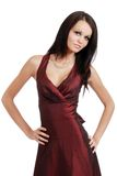 Young woman wearing a burgundy dress Stock Image