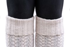 Young woman wearing cable knit leg warmers ivory color isolated on white. Background stock images