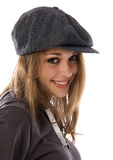 Young woman wearing a cap. Portrait of a young woman against a white background royalty free stock images