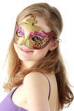 Young woman wearing carnival mask Stock Photography